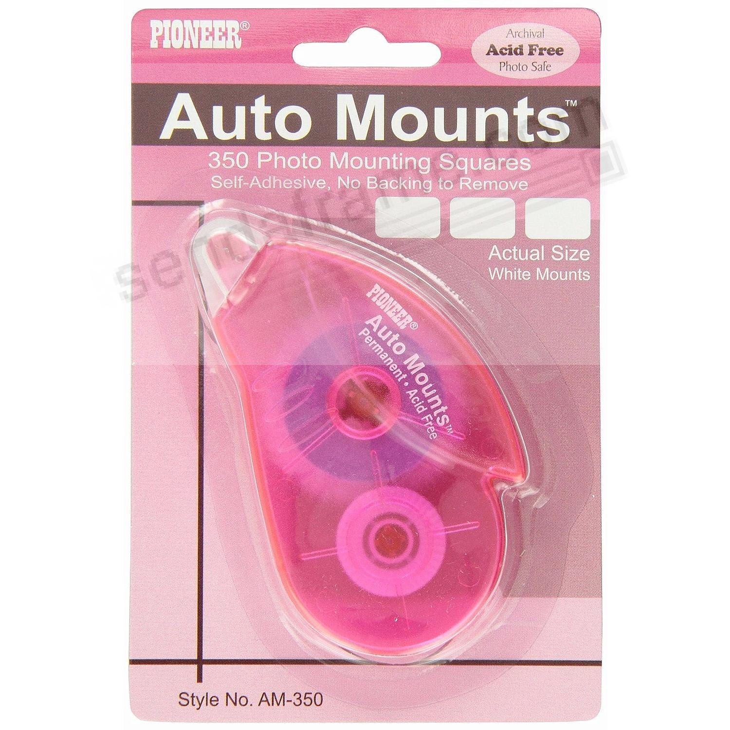 White Auto-Mounts in pink tape runner - the hi-tech way to prepare your album